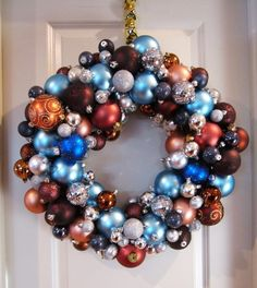 Christmas Ball Wreath--I like that this one keeps the caps showing and uses a less expensive grape-vine wreath.