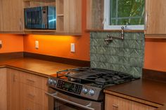 Natural gas range with pot filler and New Microwave