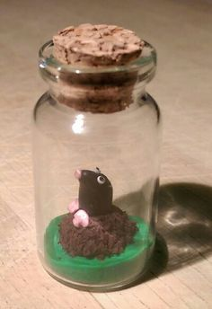 Polymer clay bottle charm, mole
