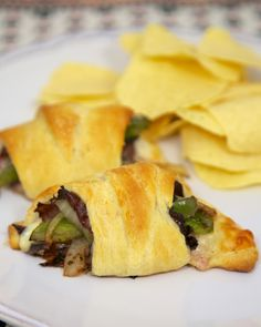 Philly Cheesesteak Crescents - roast beef, peppers, onion and horseradish sauce wrapped in a crescent roll. Perfect for a quick lunch or dinner!