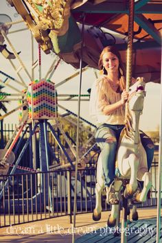 fun carousel shot - love senior pictures - senior pose with carnival setting      http://www.facebook.com/dream.a.little.dream.photography  www.alittledreamphotography.com