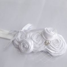 $11.99. White rolled rosette headband with a bird net and rhinestone Blessing Christening headband Tot Shot Boutique   Price: $12.99