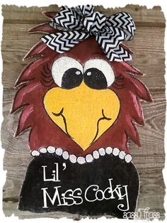 Sassy Gamecocks Lil Miss Cocky Door Hanger! I Absolutly Love This. - 'Lil Miss Cocky is quite the Sassy Southern Belle! I gotta have this! Burlap Door Decorations, Wooden Wreaths, Burlap Door Hangers, Gamecock Nation, Gamecocks Football, Doodle Doo, South Carolina Gamecocks, Hand Painted, Painted Rocks