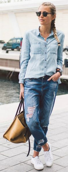Janni Deler looks ultra cool in this denim on denim style which consists of dark denim jeans, and a lighter denim shirt. This look is great worn with casual white sneakers and a leather bag. Denim On Denim, Light Denim Shirt, Denim Shirt With Jeans, All Jeans, Denim Style, Dark Denim, Denim Shirts, Celine, Denim Fashion