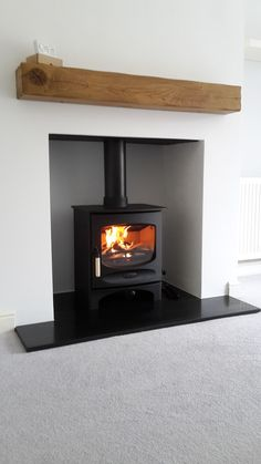 Hottest No Cost Fireplace Hearth granite Ideas Charnwood multifuel with granite hearth and rustic Oak Beam Wood Burner Fireplace, Fireplace Hearth, Modern Fireplace, Fireplace Design, Fireplaces, Log Burner Living Room, Living Room With Fireplace, Granite Hearth, Freestanding Fireplace
