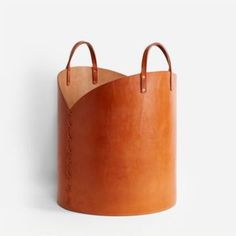 Tan Leather Log Basket by Otis Ingrams, a large storage basket made from two large sheets of leather with a wooden base. Leather Apron, Tan Leather, Luxury Wedding Gifts, Dustpans And Brushes, Harvest Basket, Knit Basket, Basket Weaving, Large Storage Baskets, Paper Basket
