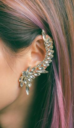 A statement ear cuff is a must-have accessory that gives just the right amount of edge to an outfit. Inspired by Jem and the Holograms.
