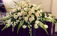 An all white  and neutral casket spray, this funeral piece would be appropriate for any funeral.