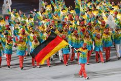 Maria Hoefl-Riesch carries the flag for Germany during the opening ceremony at the Sochi Winter Olympics on Feb. 7, 2014.