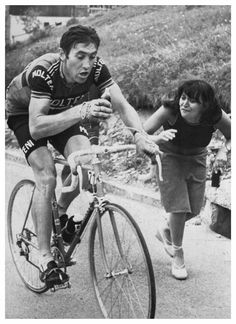 """rollersinstinct: """"A fan gives encouragement to Eddy Merckx as he takes a drink during the 1976 Giro d'Italia from Robert's Flickr stream. """""""