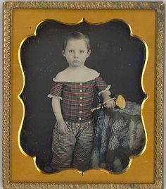 Boy with toy horn - great early hand tinted daguerreotype.