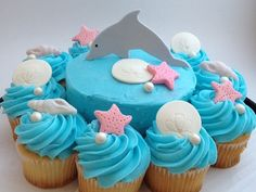 Edible Cake/Cupcake Decorations Includes: 1 dolphin, 4 sand dollars, 4 starfish, 4 seashells, and 13 pearls Pearls and dolphin are coated with