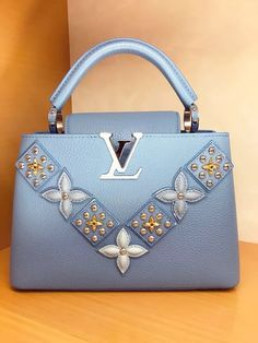 have you like this color bag? blue louis vuitton capucines flower bag