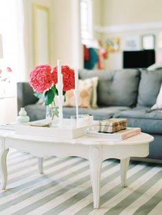 Like the stripes on rug, french provincial style coffee table and pop of pink