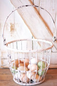 I have a black wire egg basket like this--use it for Easter eggs me and my kids have dyed thru the years.