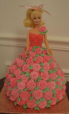A Wirl Of Roses This cake was made from the wonder mold pan and the roses are ma. Wirl Of Ro Doll Cake Designs, Cake Decorating Designs, Cake Decorating Videos, Barbie Doll Birthday Cake, Frozen Birthday Cake, Birthday Cake Girls, Cake Icing Tips, Bolo Barbie, Dress Cake