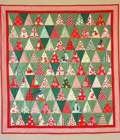 Triangle Christmas Quilt Kitschy Christmas Quilt by Amy Smart at Diary of a Quilter. Thousand Pyramids design.Kitschy Christmas Quilt by Amy Smart at Diary of a Quilter. Thousand Pyramids design. Christmas Tree Quilt, Christmas Quilt Patterns, Christmas Sewing, Noel Christmas, Retro Christmas, Christmas Crafts, Christmas Quilting, Modern Christmas, Christmas Patchwork