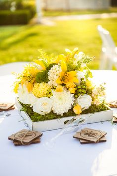 yellow and white flowers on wooden trays //