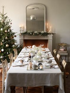 Use a linen tablecloth and layer with white china and classic glassware highlighted with copper cutlery to create a stunning Christmas dining table. Bowels of Gypsophilia down the table centre give a fairytale feel. For more Christmas inspiration visit housebeautiful.co.uk