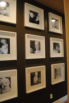 like the dark wall with white frames - this would look good in hallway