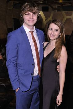 Evan Peters and Emma Roberts cuddled up for a picture at the Tribeca Film Festival premiere of Adult World