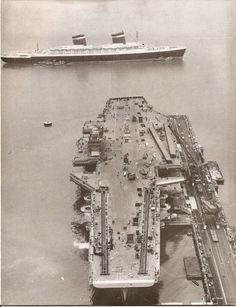 """In 1959, the SS United States comes into Newport News for it's annual """"check up"""" and passes The Forrestal , still under construction"""