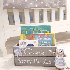 NEW FOR 2016!!!! - PERSONALISED WOODEN CHILDRENS Book STORAGE BOX Measurement W23cm x D32cm x H15cm A gorgeous personalised box that has been hand painted in a lovely grey that will lend itself well to blend in any home or childs Bedroom. Personalised and decorated with the name of your choice in decals in a movie theme that offers a unique and stylish storage solution for your childs favourite Books as shown in photo. Please state the name you would like added to your box at time of purc...