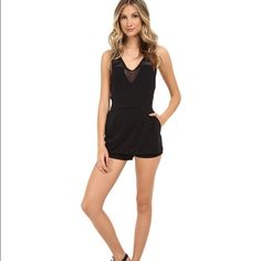 Sale! Free People knit jacquard match point romper Features a Jacquard texture all around. Size medium with a V-neckline and sleeveless. Inseam is 4 1/2 inches. 98% polyester and 2% spandex Trim is 100% cotton. Side hand pockets and back zip closure. Free People Dresses