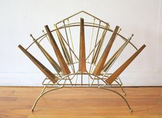 Art deco magazine holder rack with am atomic sunburst design Magazine Holders, Hand Fan, Antique Furniture, Mid-century Modern, Art Deco, Mid Century, Retro, Antiques, Vintage