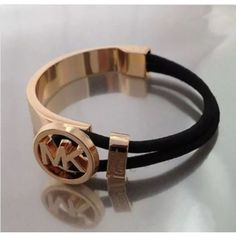 Stylish gold plated bracelet Stylish gold plated bracelet with box. Initial and gold setting 1/2 inch. Black heavy elastic to make bracelet adjustable to fit anyone. High quality Jewelry Bracelets