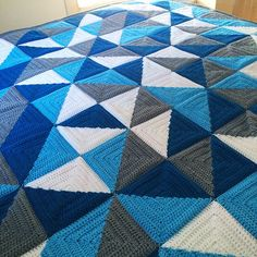 Half Square Triangle Love. Love this blanket. Not sure if it's the colours or the pattern or both but I like it.