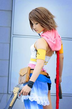 Look at me venture into cosplay... This Yuna (FFX) cosplayer has a rather accurate real world interpretation of her hair from the game, with the many layers in the back.  This also looks to be heavily styled and probably has product to hold the shape.  Lots of work. Look at me talk and not know what i'm talking about.