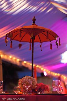 Cute centerpiece - these umbrellas are $50 on a wholesale site