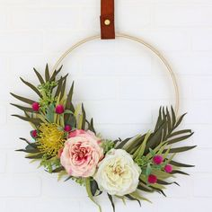 Learn how to make a modern Spring wreath with an embroidery hoop and some beautiful faux florals.