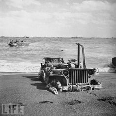 The volcanic ash that makes up much of the beach of Iwo Jima proves inhospitable to American fighters and their vehicles, like this wrecked Jeep, during the month-long 1945 battle.
