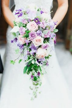 By Signature Flowers, Emma Newman Lilac shower bouquet Wedding flowers Floristry. By Signature Flowers, Emma Newman Lilac shower bouquet Wedding flowers Floristry Clematis Bridal bouquet Lilac and p Cascading Wedding Bouquets, Summer Wedding Bouquets, Cascade Bouquet, Purple Wedding Flowers, Bride Bouquets, Bridal Flowers, Flower Bouquet Wedding, Spring Wedding, Floral Wedding