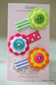 Felt Flower Snap Clips . itty bitty flowers . Stripes and Dots . Trio of Felt Flower Snap Hair Clips. $7,50, via Etsy.