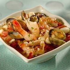 Bodega Bay Cioppino Ingredients• 2 tablespoons olive oil • 1 large onion, chopped • 3 cloves garlic, crushed or to taste • 2 (28 ounce) cans diced tomatoes with juice • ½ cup dry white wine • ¼ cup chopped fresh parsley • ½ teaspoon dried basil • 2...