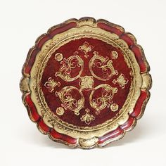 Round gold and red florentine tray with ornate details.  Perfect for a dessert display or on a coffee table. Measures 9.5 inches in diameter.