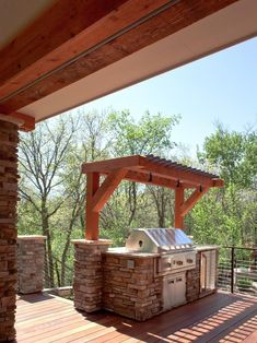 Terrific Outdoor Grill Exhaust And Ventilation: Awesome Deck Area With Small Pergola Over The Grill Defines And Outdoor Kitchen Using The Stone To Build The Bar ~ outmc.com Outdoor Design Inspiration