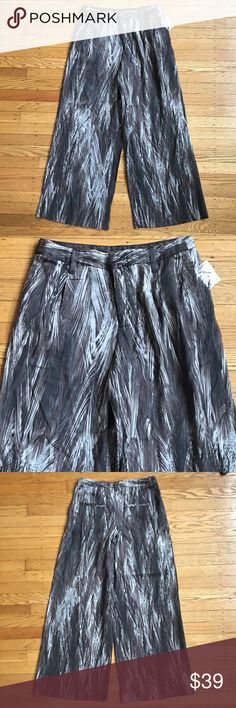 "Free People Feather Print Extreme Wide Leg NWOT. Extra Button tag still attached. Size 2. Waist 15"" one way. Inseam 31"" Leg opening 13"". Pleated High Waist and Front Button Zip Closure. These pants feature belt loops and have room to lengthen if needed. 100% Tencel Free People Pants Wide Leg"