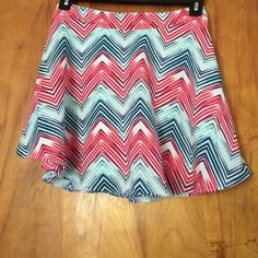 Colorful Skater Skirt Super cute skater skirt with white blue and pink in it. Girls size XL(16) but fits juniors or womens size small. Made of polyester and is on the shorter side. Only worm very fee times and is good as new with no signs of wear. By&by Skirts Circle & Skater
