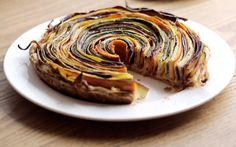 SPIRAL VEGETABLE TART - I would use a Cauliflower Béchamel sauce on the bottom instead of the crème fraiche. What an elegant looking side dish. Check Out This Video Of A Spiral Vegetable Tart, Then Try The Recipe Vegetable Tart, Vegetable Dishes, Good Food, Yummy Food, Tasty, Vegetarian Recipes, Cooking Recipes, Vegetarian Dish, Baker Recipes