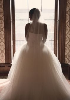 Bride Silhouette in a large window. Vera Wang Tulle Princess Wedding Gown. Bolling Haxall House, Richmond, VA Wedding.  www.tinatakemyphoto.com