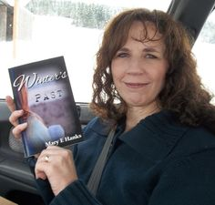 Mary E Hanks holding her first book--Winter's Past! A contemporary Christian romance. Dreams do come true!