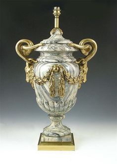 A cipollino marble and gilt bronze mounted vase