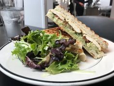 This popular catering company has opened a new lunch spot at the Des Moines Art Center Lunch Restaurants, Slow Roasted Tomatoes, Pastry School, Lemon Salmon, Lunch Menu, Basil Pesto, Salad Sandwich, Almond Cakes, Apple Crisp
