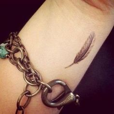 Little wrist tattoo of a feather.                                                                                                                                                                                 More