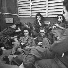 Group of US Army Nurses relaxing during stopover on Guam en route to their final destinations ~