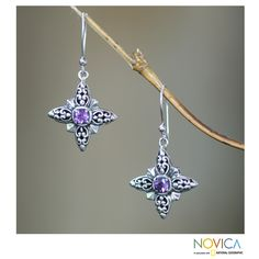 Amethyst centers bright stars in fashionable earrings from Wayan Asmana. Handcrafted of sterling silver, the earrings of oxidized contrasts.